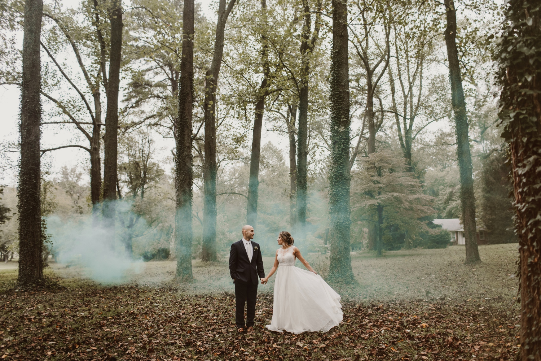 Baltimore wedding photographer outdoor Maryland wedding ceremony   forest earthy Annapolis wedding   bride and groom smokebomb portraits
