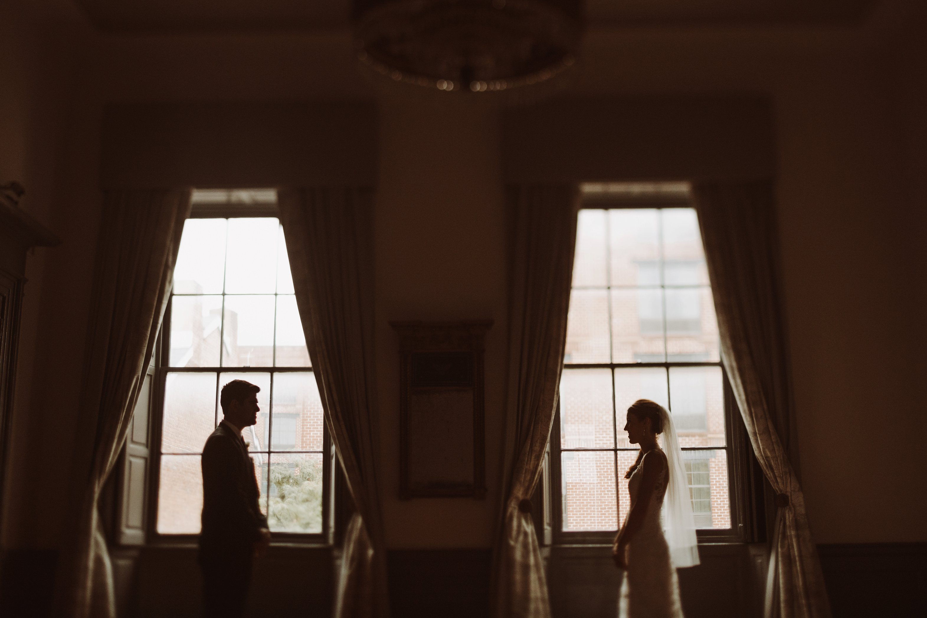 bride and groom first look 1840s Ballroom Baltimore Maryland wedding photographer