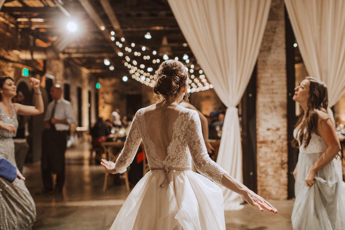 wedding reception bistro lights Mt. Washington Mill Dye House Baltimore wedding photographer