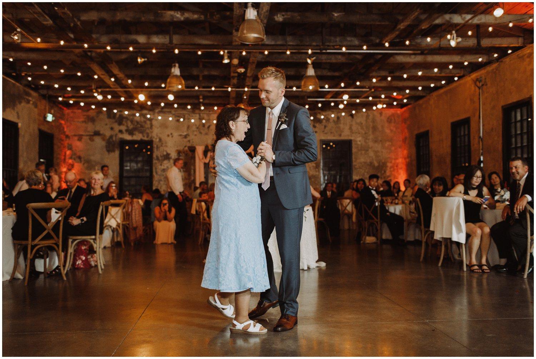 Baltimore wedding photographer   Mt Washington Mill Dye House wedding reception   mother and groom dance   Baltimore Maryland wedding