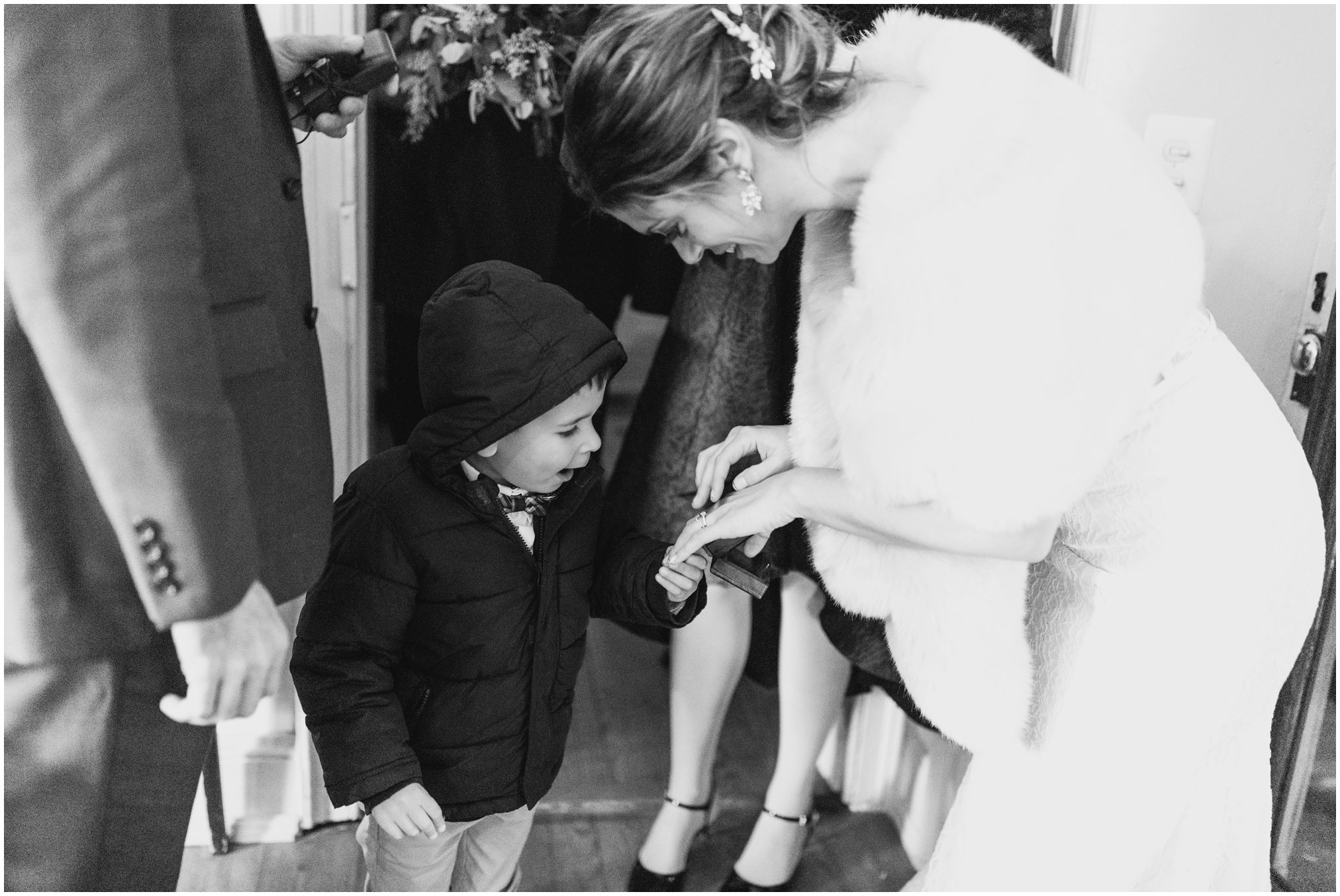 Bride showing her ring to little kid