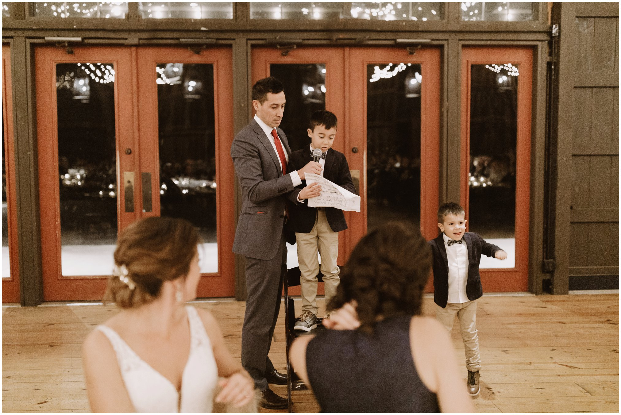 Wedding speeches in barn with string lights