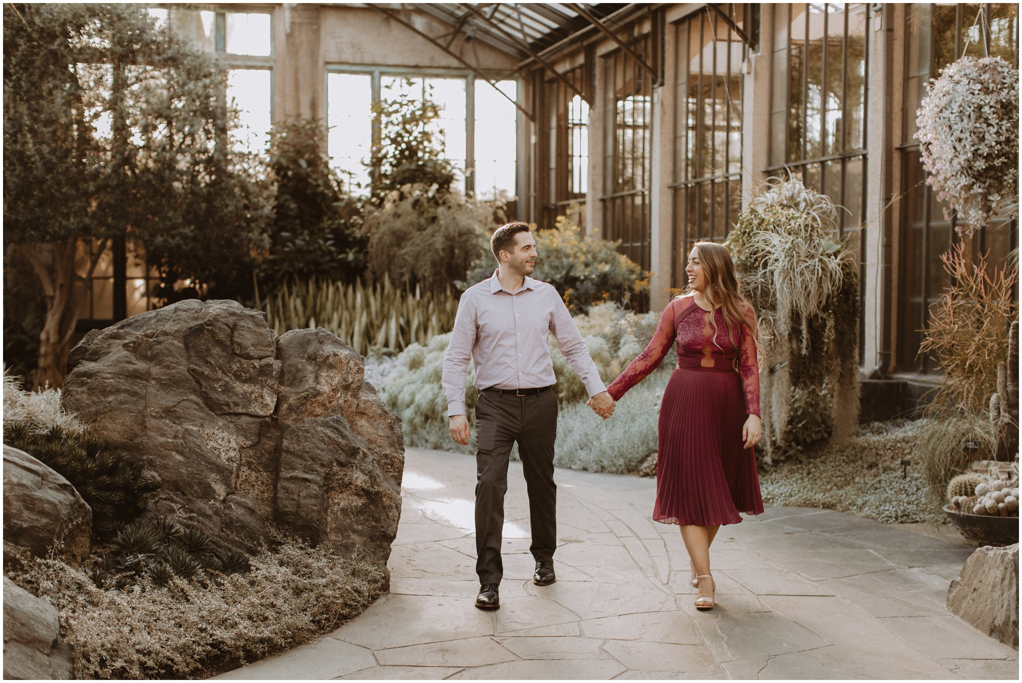 Bride and Groom Walking in Greenhouse