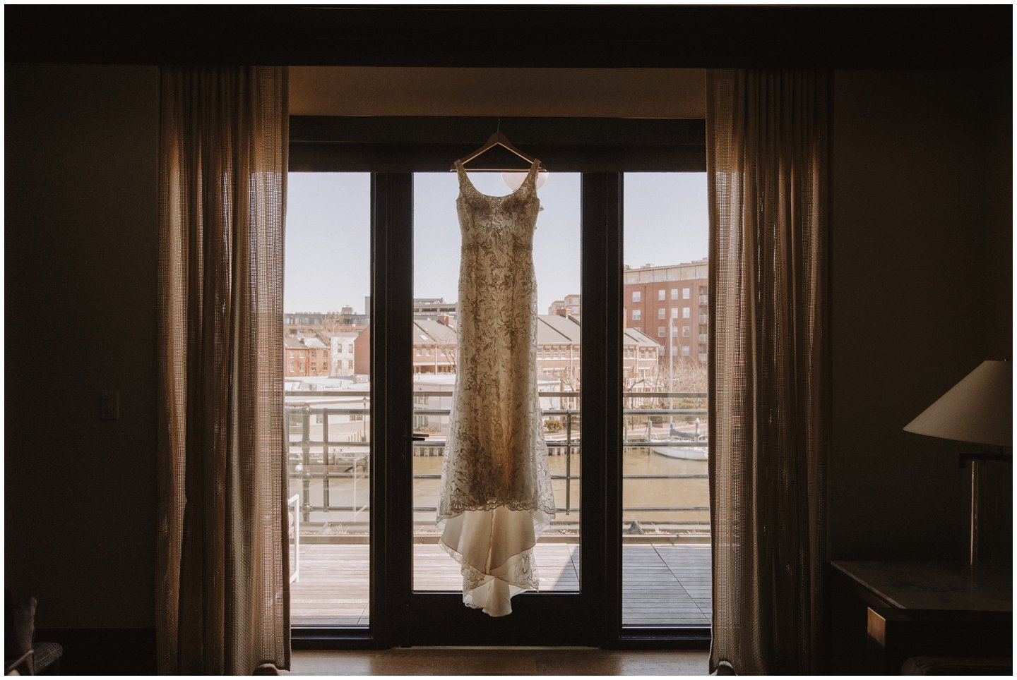 Modern wedding dress hanging in a window