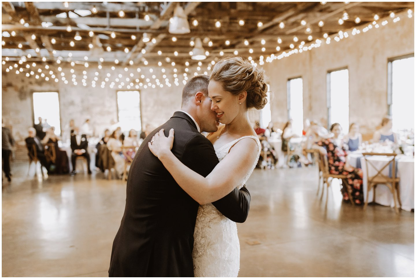 bride and groom first dance under bistro lights