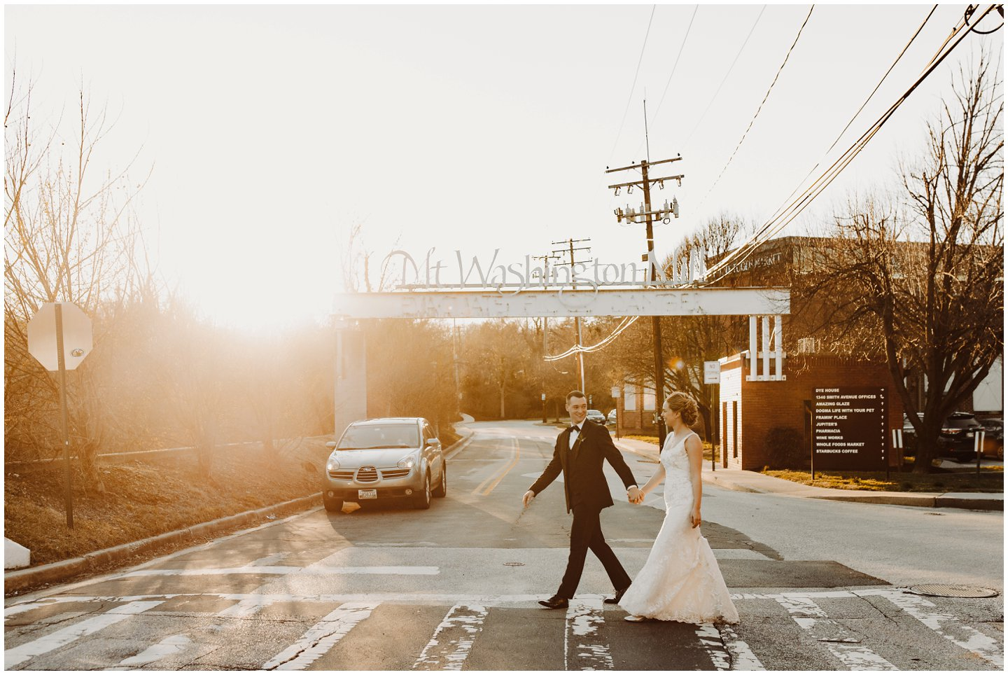 bride and groom crossing the street at golden hour