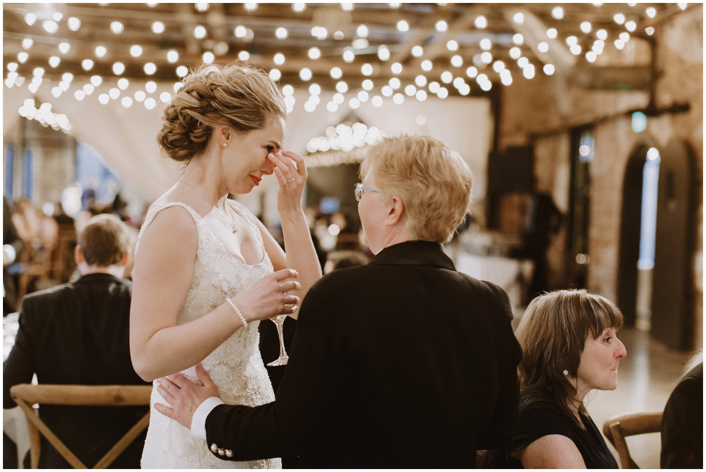 emotional bride at wedding reception