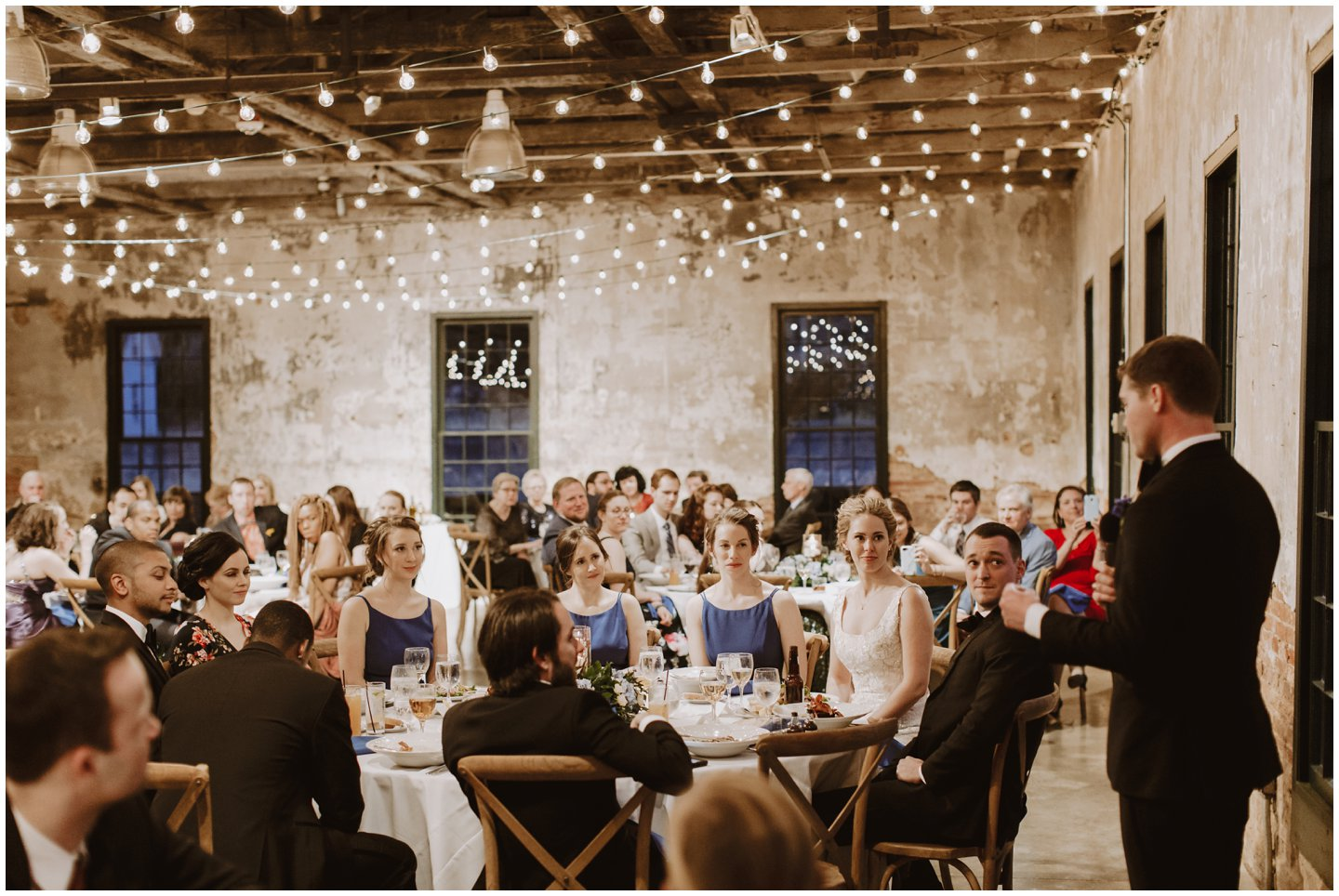 modern wedding reception with bistro lights